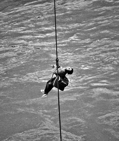 Tibetan postal worker Nyima Lamo crosses the Lacang River on a zip line.